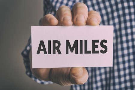 Foto de Businessman shows AIR MILES card - Imagen libre de derechos