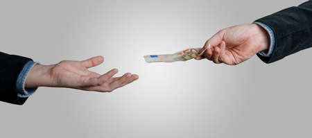Foto de Businessman`s hand holding Euro currency, offers 50 euro bank note money. Giving money, paying by cash, business, banking, loan concept. - Imagen libre de derechos
