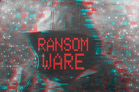 Foto de Ransomware cyber criminal concept with faceless hooded hacker - Imagen libre de derechos