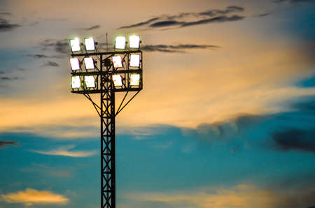 Pillar spotlights football field in the background blue sky at sunset  mural
