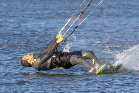 Photo pour Kiteboarding. Fun in the ocean, Extreme Sport Kitesurfing. Closeup Darkslide. - image libre de droit
