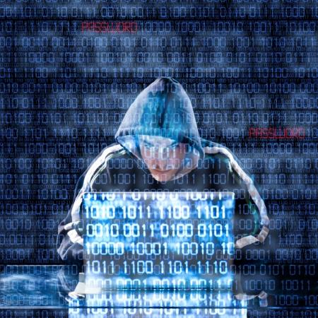 Foto de Hacker typing on a laptop with binary code in background - Imagen libre de derechos