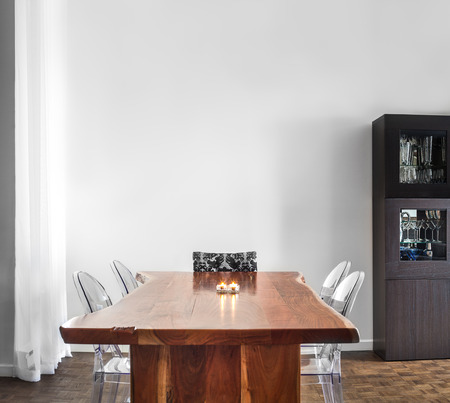 Foto de Modern and Contemporary dining room table and decorations with blank wall for your text, image or logo. - Imagen libre de derechos