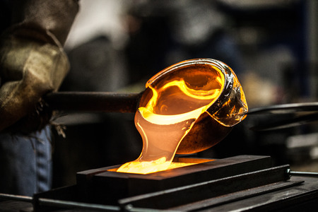 Photo for Pouring Melted Glass into Graphite Mold in Workshop - Royalty Free Image