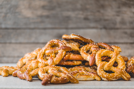 Foto de Stack of Fresh Pretzels on the counter top with Rustic background - Imagen libre de derechos