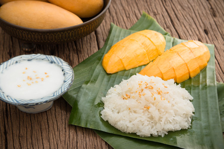 Photo for Still life sweet sticky rice with mango (Barracuda mango) and coconut milk - Royalty Free Image