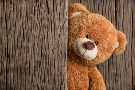 Photo for Cute teddy bears with old wood background - Royalty Free Image