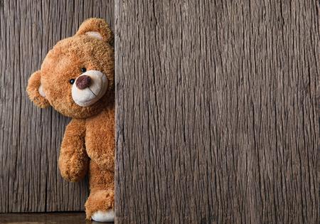 Foto de Cute teddy bears on old wood background with copy space - Imagen libre de derechos