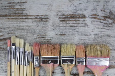Photo for Set of paintbrushes in a wood background, vintage - Royalty Free Image