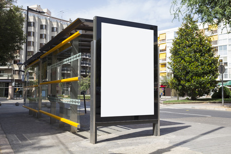 Photo pour Blank billboard for advertisement, in a bus stop at the street - image libre de droit