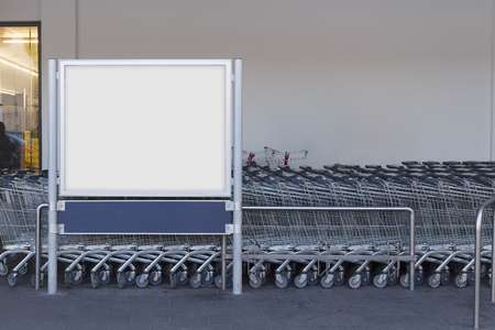 Photo for Blank billboard mock up in a supermarket, in front of shopping carts - Royalty Free Image