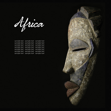 Photo for African mask over black  - Royalty Free Image