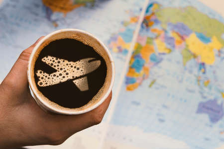 Photo pour Taking a coffee and thinking of traveling around the world. - image libre de droit