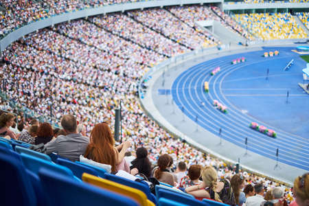Photo for The crowd at the stadium are sitting listening to the congress of Jehovah's Witnesses - Royalty Free Image