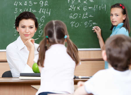 Smart teacher questions pupils at mathematics