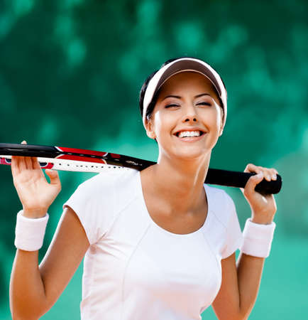 Sportswoman with racquet at the tennis court  Healthy lifestyle