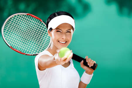 Woman in sportswear serves tennis ball. Competition