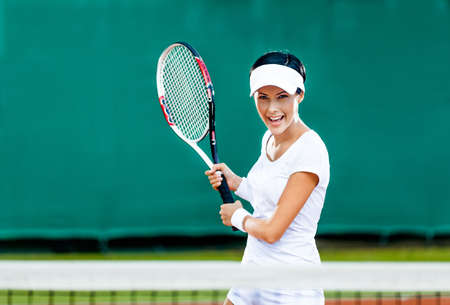 Woman in sportswear plays tennis at competition