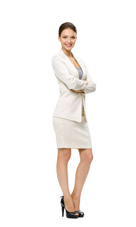 Photo pour Full-length portrait of business woman with her hands crossed, isolated on white. Concept of leadership and success - image libre de droit