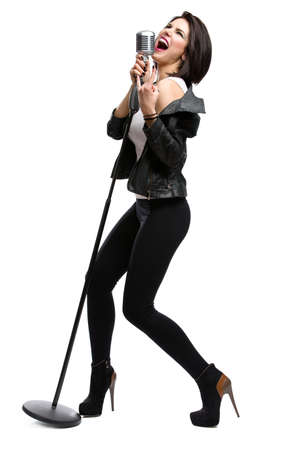 Photo for Full-length portrait of rock singer wearing leather jacket and keeping static microphone, isolated on white. Concept of rock music and rave - Royalty Free Image