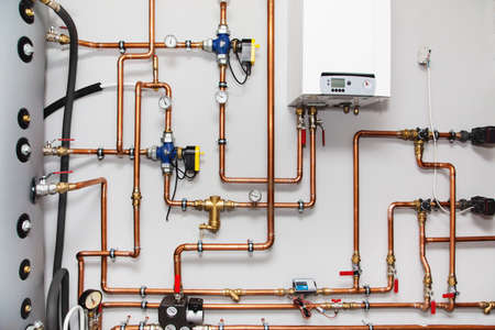 Photo for Heating system with copper pipes, valves and other equipment in a boiler room - Royalty Free Image
