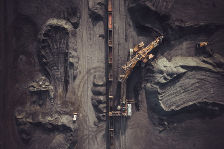 Photo for Coal mining. Aerial view. Excavator loading train cargos - Royalty Free Image