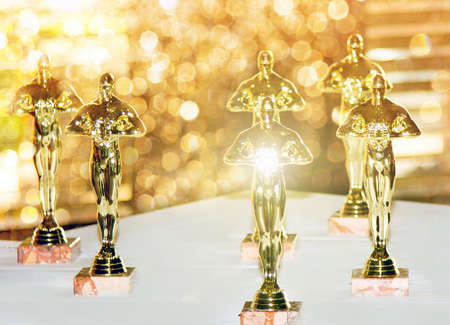 Photo pour Figurines, award, Oscar. The concept of Victory, games and winnings. Background. Win and Play - image libre de droit
