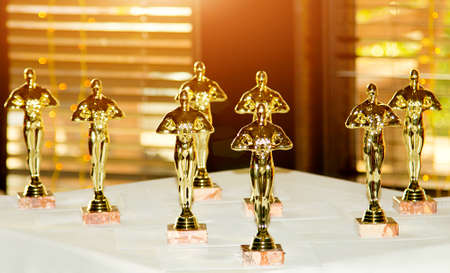 Photo for Figurines, award, Oscar. The concept of Victory, games, and winnings.  Win and Play - Royalty Free Image