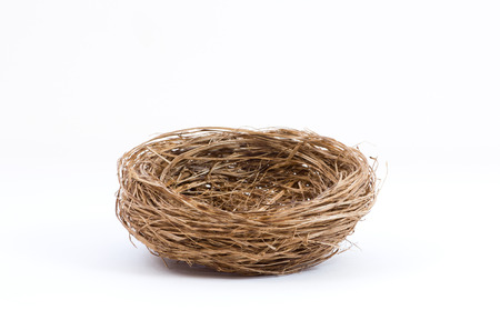 Photo pour Studio shot of an empty bird nest isolated on white background - image libre de droit