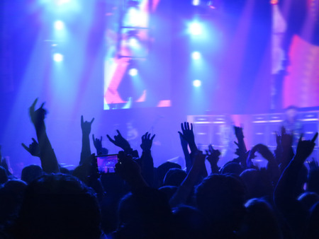 Abstract blurred concept image. Crowd surfing during a musical performance. Hand fans during a concert in fun zone people during a music entertainment public concert