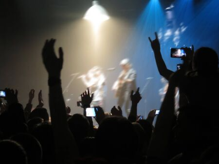 Abstract blurred concept image. Crowd surfing during a musical performance. Hand fans during a concert in fun zone people taking photographs with touch smart phone during a music entertainment public concert