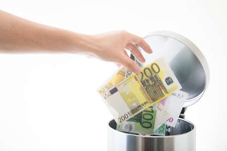 Photo for throwing away euro in waste can - Royalty Free Image