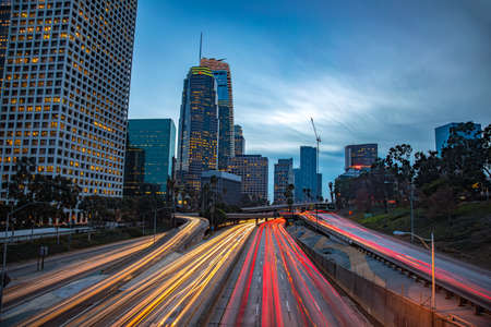 Foto de Downtown Los Angeles, California, USA skyline with trail lights - Imagen libre de derechos