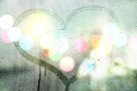 Foto de Autumn rain, draw heart on glass - love concept - Imagen libre de derechos