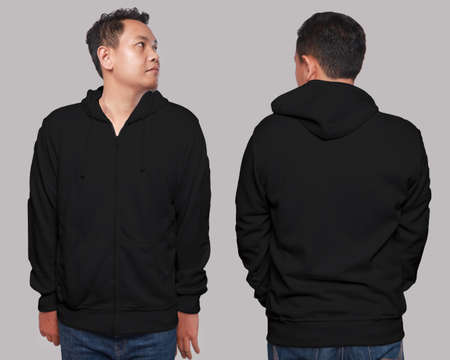 Foto de Blank sweatshirt mock up, front, and back view, isolated on grey. Asian male model wear plain black hoodie mockup. Hoody design presentation. Jumper for print. Blank clothes sweat shirt sweater - Imagen libre de derechos
