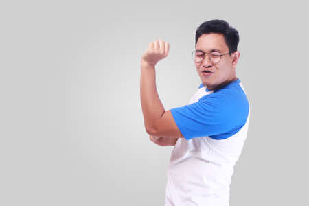 Photo for Photo image closeup portrait of a funny young Asian man dancing happily joyful expressing celebrating good news victory winning success gesture, smiling positive excited emotion while standing over grey background - Royalty Free Image