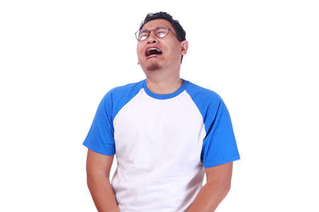 Foto de Photo image of funny Asian man crying close his eyes, sad depression frustration hopeless expression isolated on white - Imagen libre de derechos