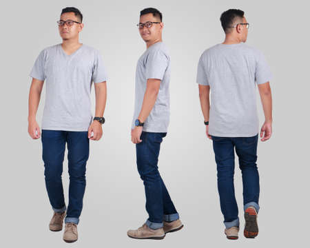 Photo pour Attractive young Asian man standing posing wearing plain grey shirt, blank t-shirt mock up for  printing, front back side view - image libre de droit