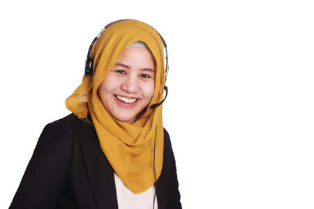 Foto de Portrait of beautiful young muslim lady wearing hijab, call center operator consultant smiling with headphones isolated on white - Imagen libre de derechos