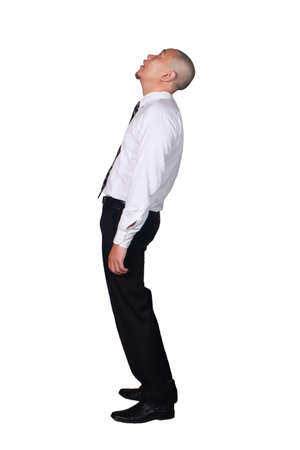 Foto de Young businessman wearing white suit and black pants deperate, looking up gesture. Isolated on white. Full body portrait - Imagen libre de derechos