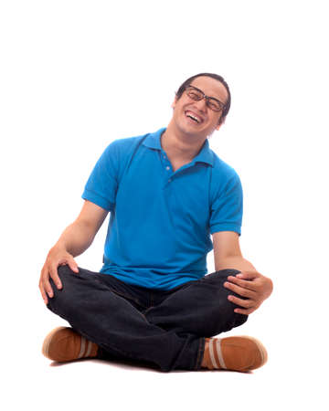 Photo for Attractive young Asian student  sitting on the floor, isolated on white, laughing hard - Royalty Free Image