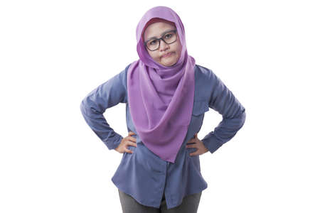 Foto de Portrait of Asian muslim woman wearing hijab showing upset disappointed expression. Isolated on white - Imagen libre de derechos