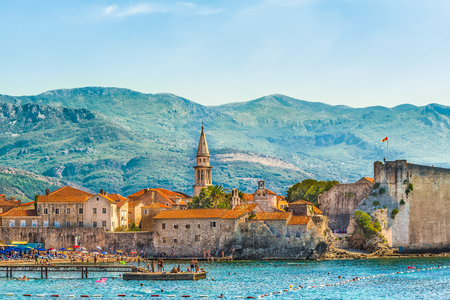 Foto de Budva, Montenegro - August 18, 2017: View of the old town and the citadel. The Balkans, the Adriatic Sea, Europe. - Imagen libre de derechos