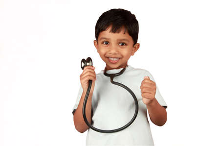 A boy with a stethoscope in a white background