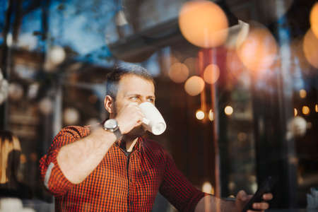 Photo pour Young attractive man drinking coffee at lunch time - image libre de droit