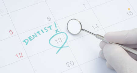 Photo for A note of a dentist appointment on a calendar, dental check up - Royalty Free Image
