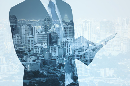 Photo for Double exposure of city and business man using digital tablet - Royalty Free Image