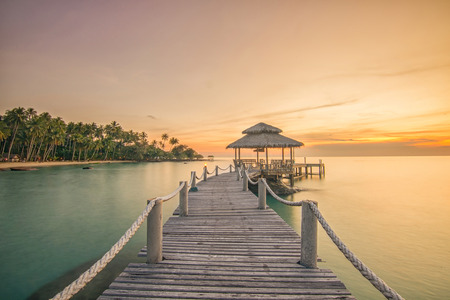 Photo for Summer, Travel, Vacation and Holiday concept - Wooden pier between sunset in Phuket, Thailand - Royalty Free Image
