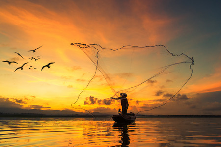 Photo for Fisherman fishing at lake in Morning, Thailand. - Royalty Free Image