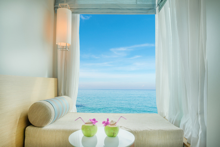 Foto de Summer, Travel, Vacation and Holiday concept - Beautiful tropical sea view at window in resort, Phuket ,Thailand - Imagen libre de derechos
